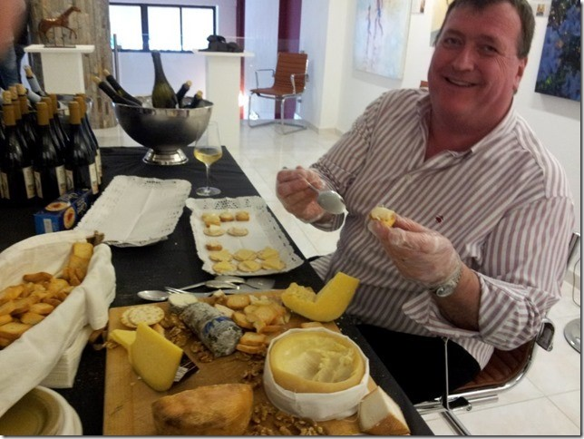 Zoie's husband Bruce was hard at work preparing the cheese for guests!